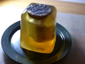 Image showing gelatine moulding material after it has set around a nutella jar