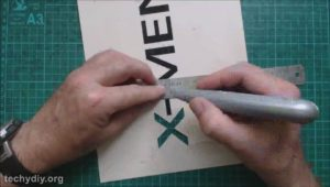 Cutout the xmen stencil with knife