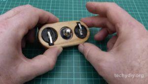 led fidget spinner bearing superglued in wooden holder