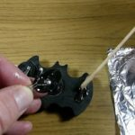 Glue battery holder on Batman